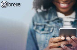 brella ad - girl holding phone